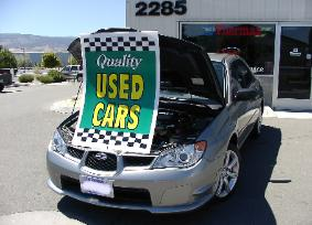 under hood used car sign